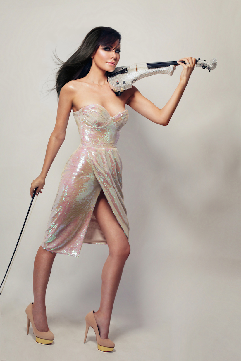 Linzi Stoppard looking beautiful in silver dress and matching Swarovski Crystal violin
