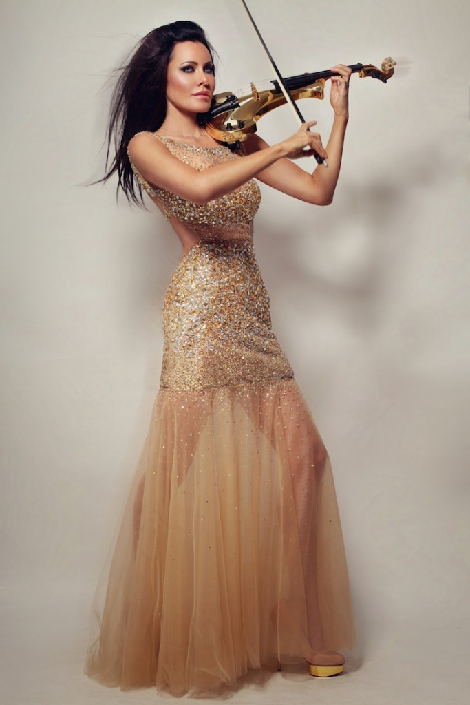 Violinist Linzi Stoppard performing on golden violin wearing shimmering gold dress