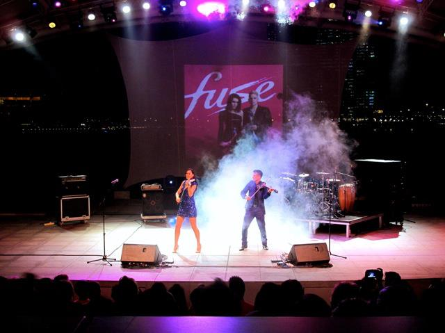 electric violinist hire london corporate entertainment singapore