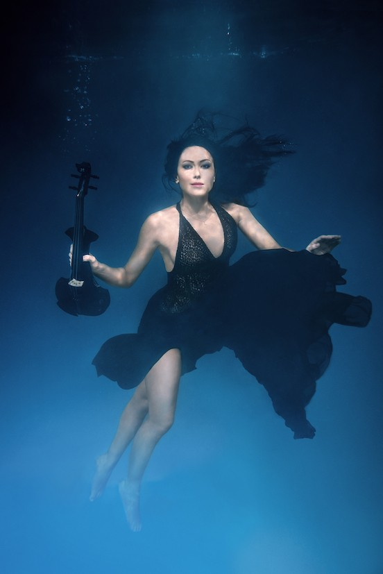 linzi stoppard goes underwater photo shoot wearing a black dress and matching electric violin
