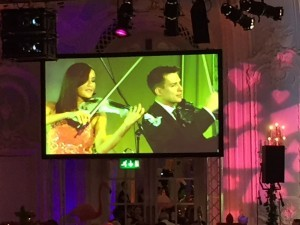 Linzi Stoppard performs with fellow FUSE violinist Ben Lee live at the Macmillan Annual Ball